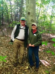 Bob and Trish Leipold with a bear-scarred beech. Black bears will find more wild fruits to feed on in the new young forest on the Leipolds' land.